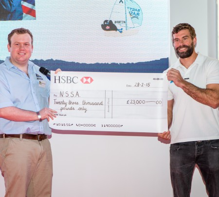 James Conway NSSA Treasurer receives cheque from Iain Percy of Andrew Simpson Sailing Foundation